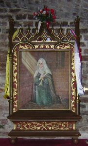 Painting in chapel of kneeling woman in dress and veil