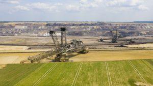 Large opencast mine with excavator