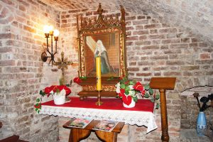 Interior of red-brick crypt chapel